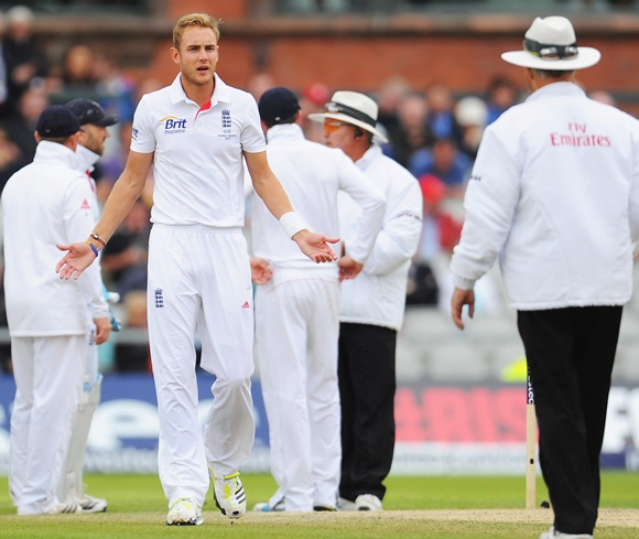 Stuart Broad of England gestures to umpire Tony Hill