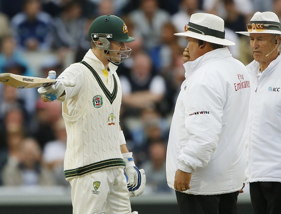 Australia's Michael Clarke (left) gestures as he talks with umpires Marais Erasmus (centre) and Tony Hill