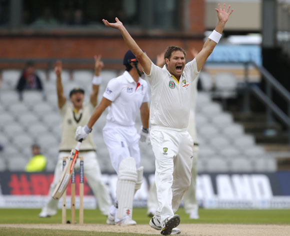 Australia's Ryan Harris (right) successfully appeals for the wicket of England's Alastair Cook (left) on the final day of the third Ashes Test at Old Trafford