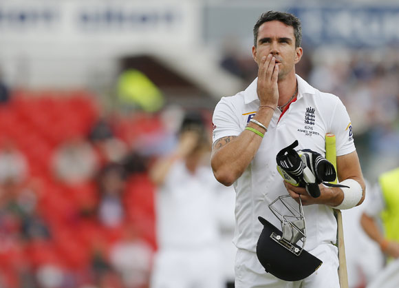 England's Kevin Pietersen walks off the pitch after being dismissed