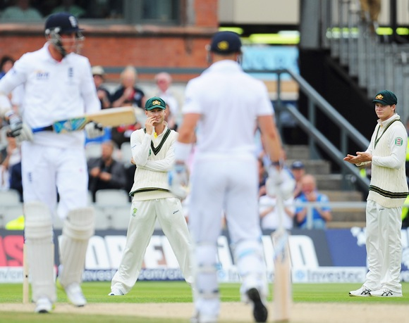 Michael Clarke of Australia looks on with Steve Smith (right) as Stuart Broad and Matt Prior of England pick up more runs
