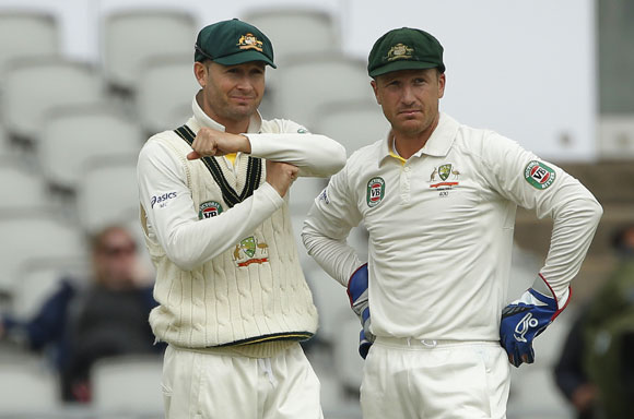 Australia's captain Michael Clarke (left) signals to review the umpires decision as he stands with Brad Haddin on the final day of the third Ashes Test
