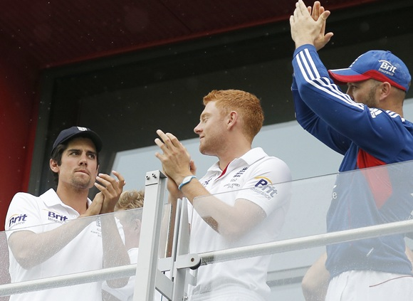 (From left) Alastair Cook, Jonny Bairstow and Matt Prior applaud the crowd from their balcony