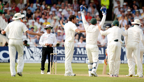 Australia's players appeal to umpire Aleem Dar for the wicket of Stuart Broad
