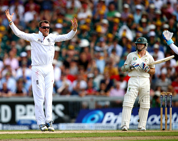 Graeme Swann celebrates after taking the wicket of Chris Rogers