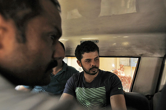 Sreesanth (right) is taken to a court in a police vehicle