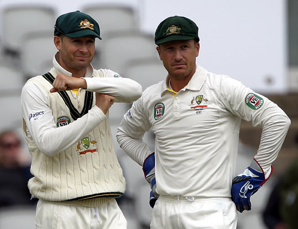 Australia's captain Michael Clarke signals to review the umpires decision as he stands with Brad Haddin