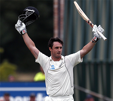 New Zealand's Hamish Rutherford celebrates making his century during the third day of the first Test against England at the University Oval in Dunedin