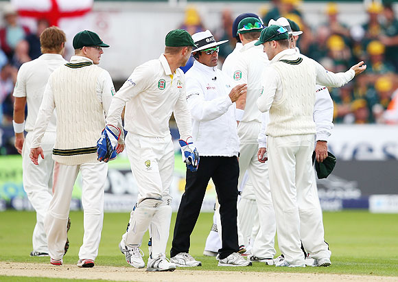 Michael Clarke of Australia speaks to Umpire Aleem Dar after he sucsessfully reviewed a decision against Joe Root of England during Day 1 of 4th Ashes Test on Friday