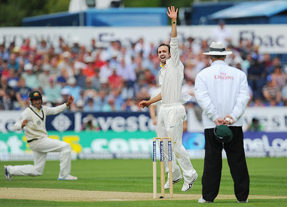 Australian fielder Usman Khawaja (left) and bowler Nathan Lyon appeal with success after dismissing Jonathan Trott on Friday