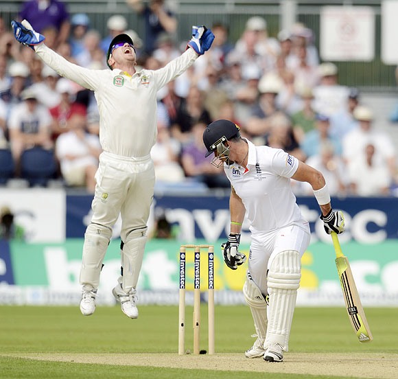 England's Kevin Pietersen edges the ball and is caught by Australia's Brad Haddin (left) on Day 1 of the 4th Ashes Test on Friday