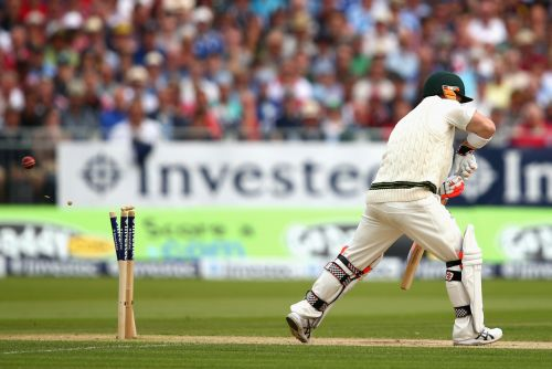 David Warner of Australia is bowled by Stuart Broad