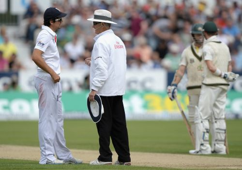 England captain Alastair Cook speaks to umpire Tony Hill after his decision give Chris Rodgers of Australia out is overruled after a referral