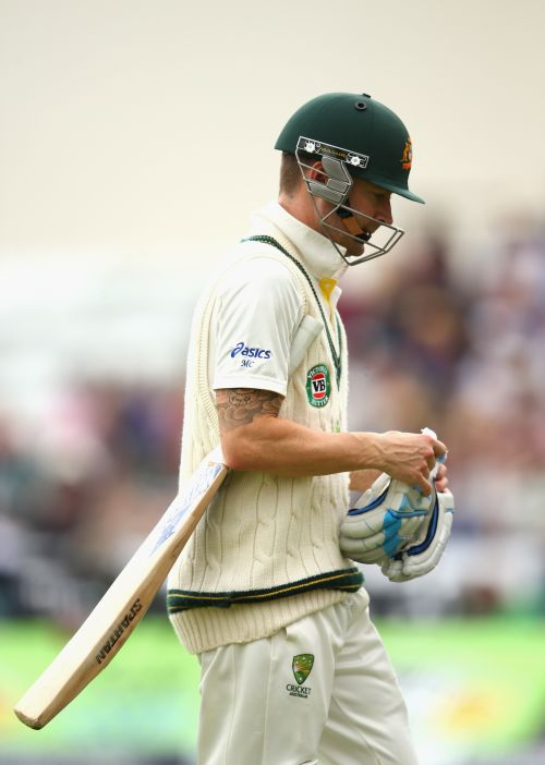 Michael Clarke of Australia looks dejected after being dismissed by Stuart Broad