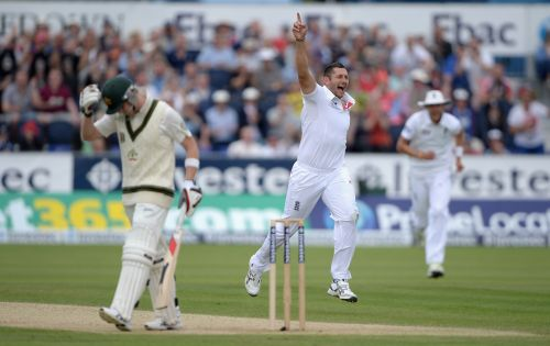 Tim Bresnan celebrates after taking the wicket of Steve Smith