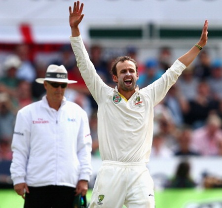 Nathan Lyon celebrates after taking the wicket of Kevin Pietersen