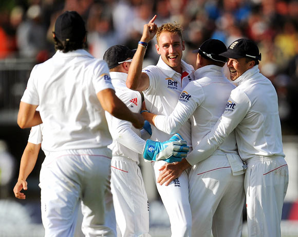 England bowler Stuart Broad celebrates with team mates after dismissing Brad Haddin