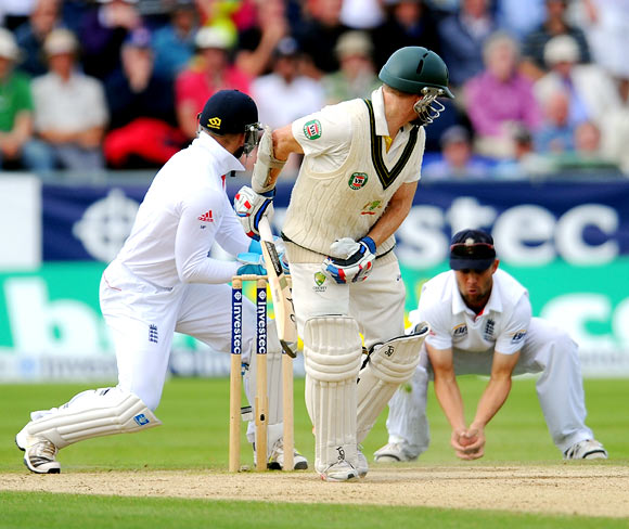 Chris Rogers is caught by Jonathan Trott off the bowling of Graeme Swann