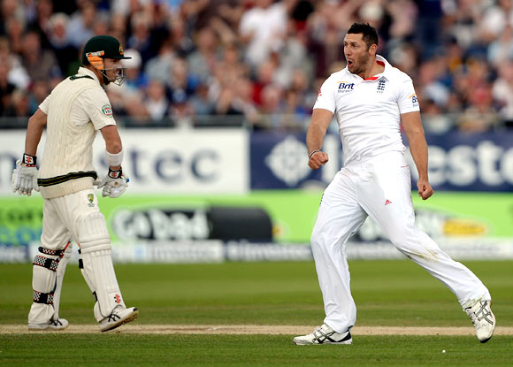 Tim Bresnan celebrates dismissing David Warner