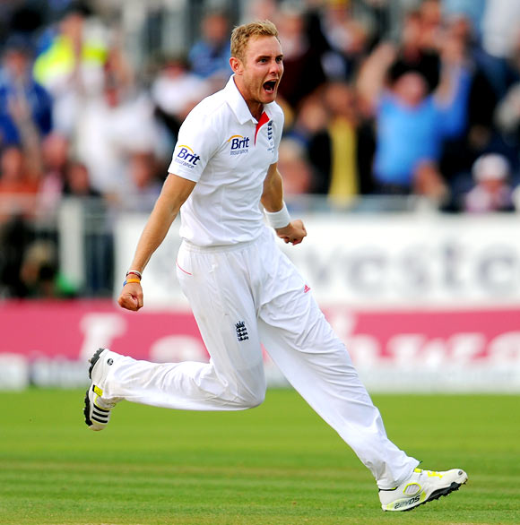 Stuart Broad celebrates after bowling Micha