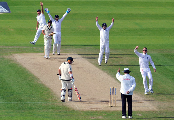Australian batsman Usman Khawaja is lbw off the bowling of Graeme Swann as Matt Prior and Jonathan Trott appeal
