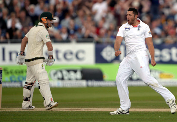 Tim Bresnan of England celebrates dismissing David Warner of Australia