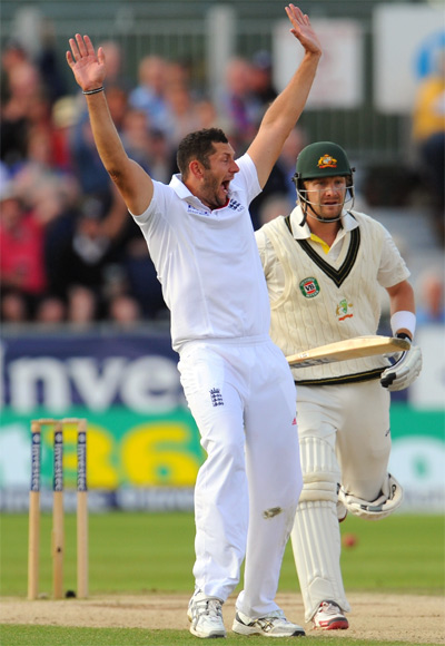 Australian batsman Shane Watson looks on as Tim Bresnan celebrates his dismissal during day four
