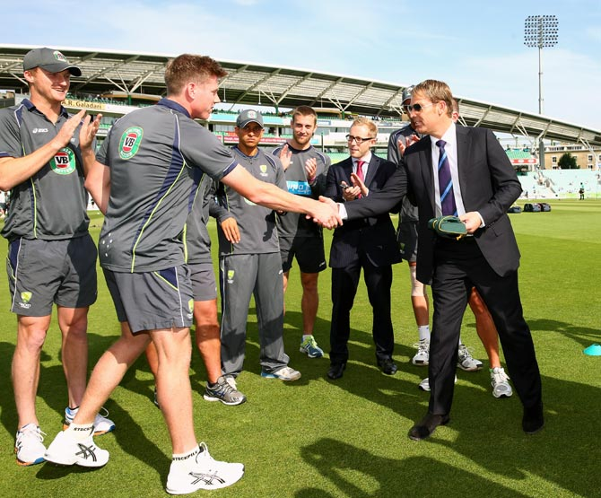 James Faulkner gets his Australian Baggy Green Test cap from Shane Warne