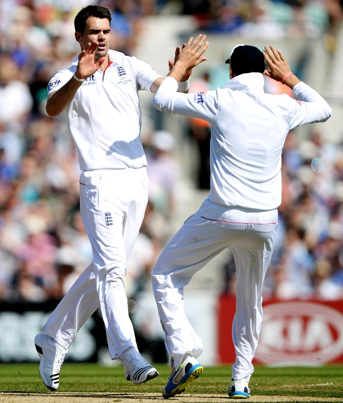 James Anderson (left) celebrates the wicket of David Warner
