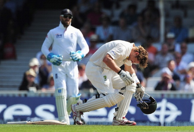 Shane Watson grimaces after being hit by a delivery from Stuart Broad