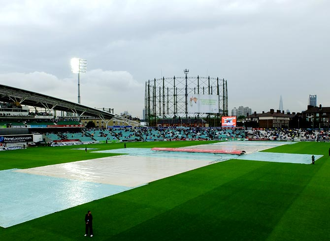 The covers are on as rain delays the start of second day's play.