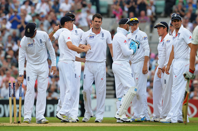 James Anderson of England celebrates the wicket of Peter Siddle of Australia with team mates