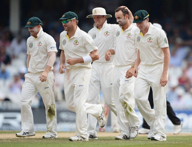 Australian players celebrate with Nathan Lyon after dismissing Joe Root