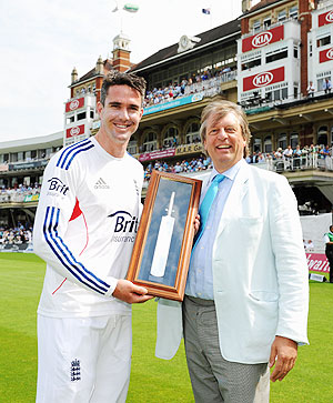 Kevin Pietersen of England receives a commemorative engraved bat from ECB Chairman Giles Clarke after becoming England's leading run-scorer in International Cricket