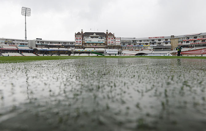 Puddles form on the pitch at the Oval in London
