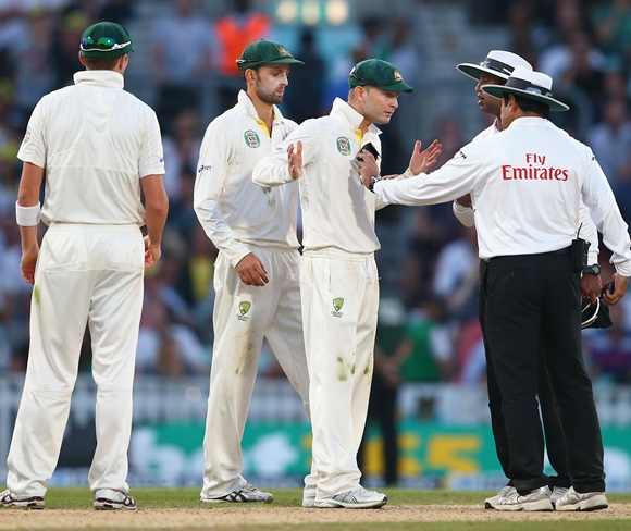 Michael Clarke of Australia remonstrates with Umpire Aleem Dar before bad light ended the match