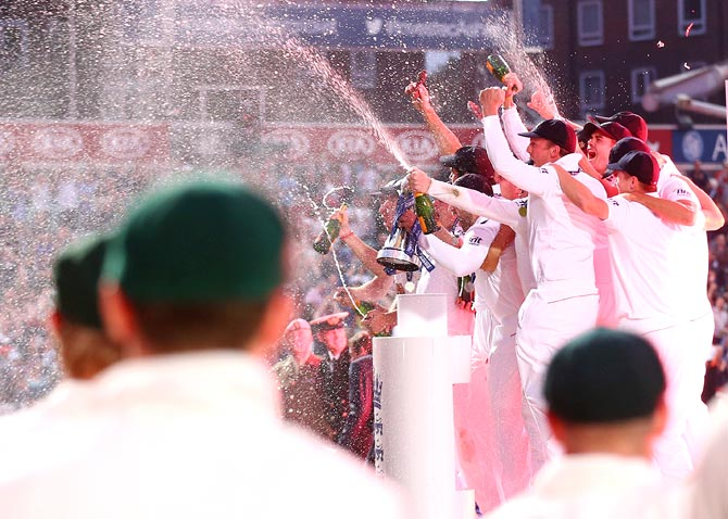 The England team celebrate after winning the Ashes