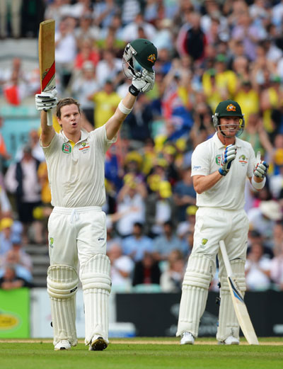 Steve Smith of Australia celebrates his century watched by Brad Haddin during Day Two of the fifth Ashes Test at The Oval