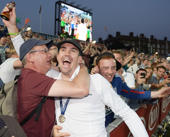 Kevin Pietersen of England celebrates with fans