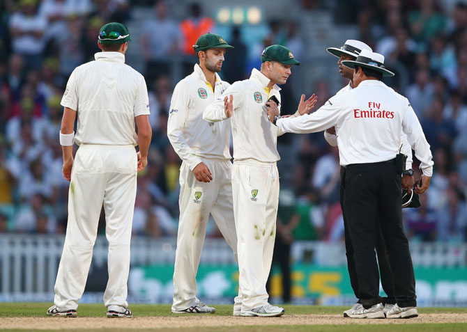 Michael Clarke of Australia remonstrates with Umpire Aleem Dar