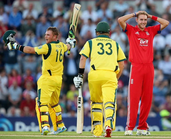 Aaron Finch of Australia celebrates his century as Stuart Broad of England looks on
