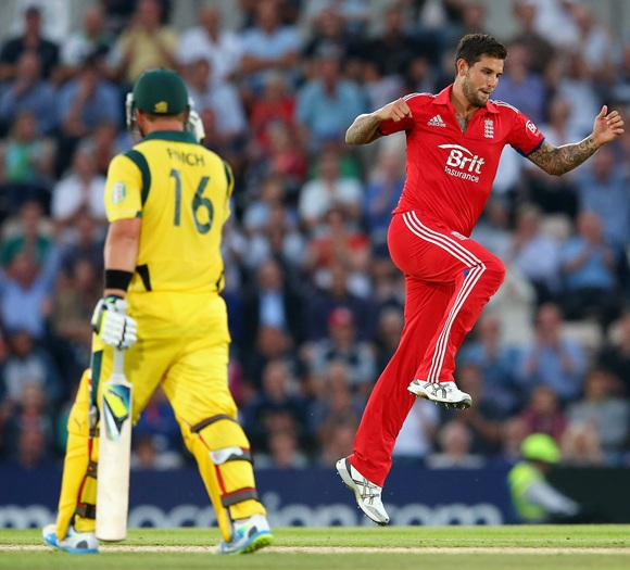 Jade Dernbach of England celebrates taking the wicket of Aaron Finch of Australia