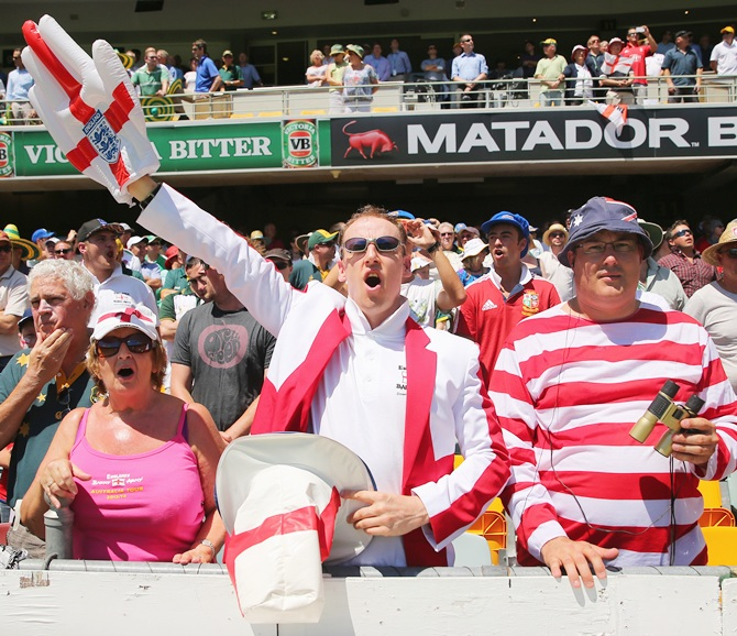 Barmy Army members stand for the national anthem