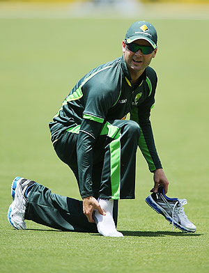 Michael Clarke inspects his ankle during a training session on Monday