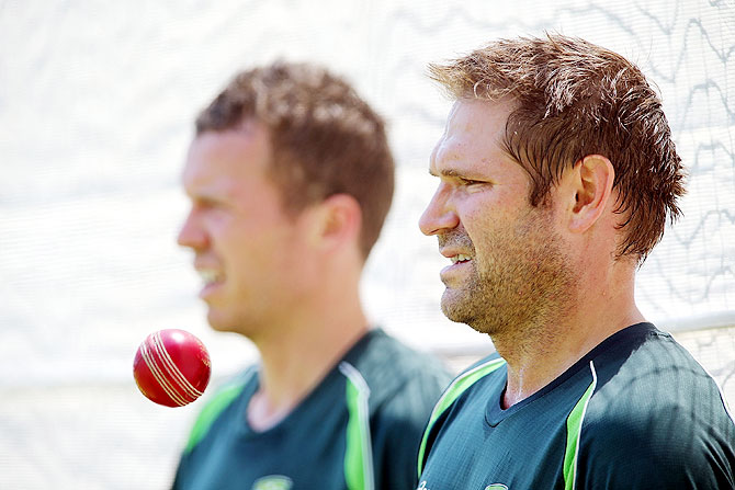Peter Siddle and Ryan Harris looks on during an Australian nets session at Adelaide Oval in Adelaide on Monday