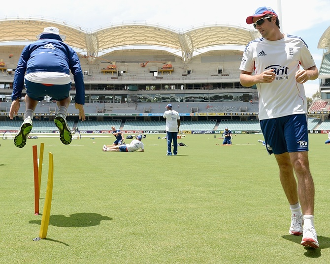 England captain Alastair Cook and Monty Panesar warm up