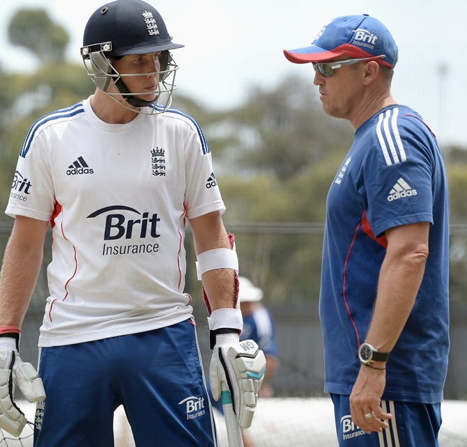 Joe Root of England speaks with coach Andy Flower