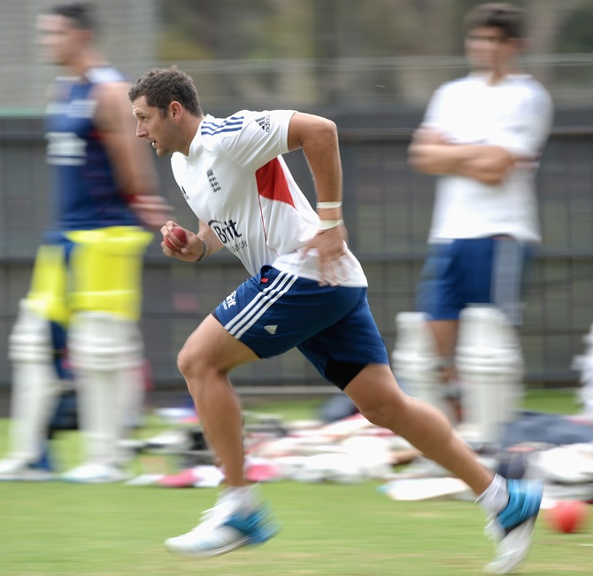 Tim Bresnan of England runs into bowl during a nets session
