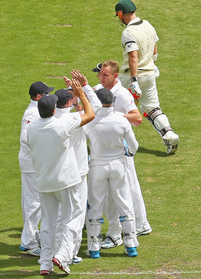 Stuart Broad of England celebrates after dismissing David Warner of Australia