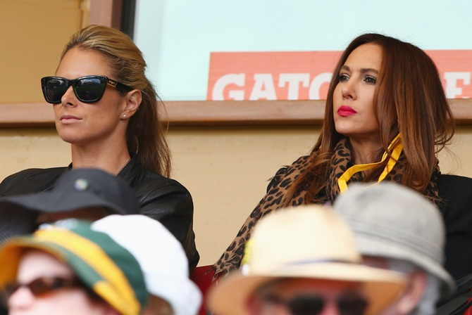 Candice Falzon, partner of David Warner and Kyly Clarke, partner of Michael Clarke look on during day one of the Second Ashes Test